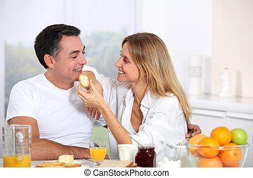 Couple having breakfast during the week end
