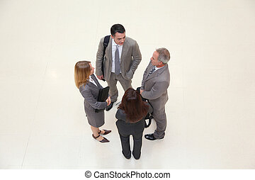 Group of business people meeting in hall