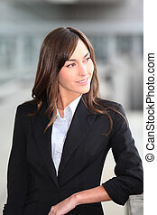 Closeup of beautiful businesswoman standing outside the...