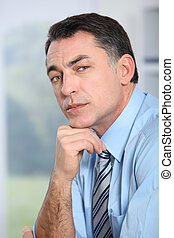 Closeup of businessman with blue shirt and tie