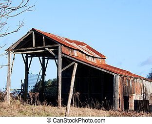 Old Delapidated Barn - Old ruined barn on the point of...