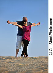 couple enjoying the sunset - relaxed young pasionate couple...