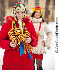 Happy girls during Shrovetide in Russia - Happy girls with...