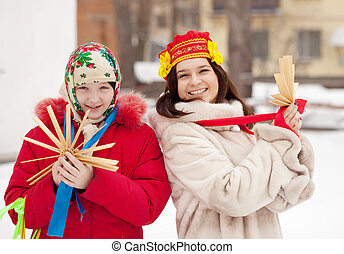 happy girls plays during Shrovetide - Two happy girls plays...