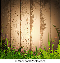 magic grass over wooden background