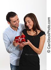 Man offering present to girlfriend