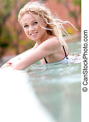 Beautiful blond woman in swimming pool