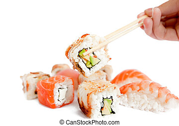 assortment of japanese sushi and roll held with chopstick