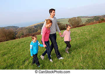 Family having a walk in countryside
