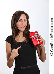 Smiling young woman with christmas gift