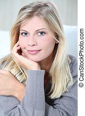 Smiling beautiful blond woman