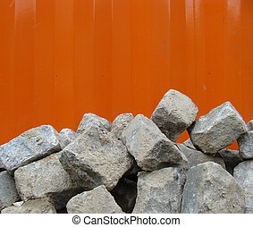 stack of cobble stone with orange backdrop...