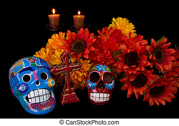 Dia De Los Muertos (Day of the Dead) Alter with decorated...