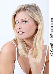 Beautiful blond woman on white background
