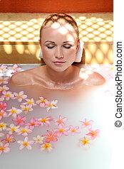 Portrait of beautiful woman in milk bath