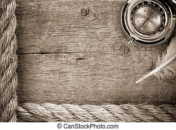 ship ropes and compass on old wood - ship ropes and compass...