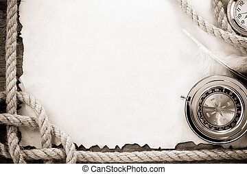 ropes and compass on old grunge old paper - ship ropes and...