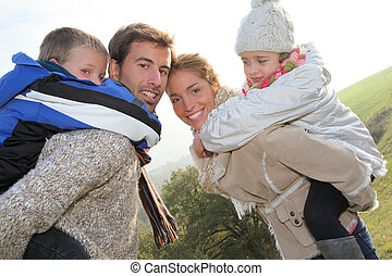 Family of 4 people in countryside