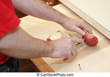 Male Hands Cutting an Apple - Hands of a man cutting a red...