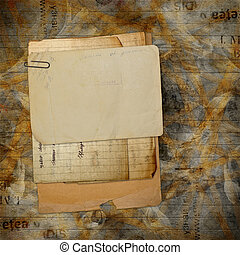 Old archive with letters, photos on the abstract grunge...