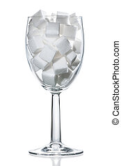 Wine glass of white sugar. - Wine glass filled with white...