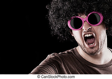 Groove - Man with funny sunglasses is grooving over black...