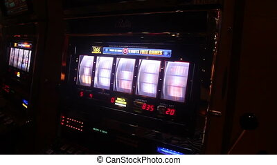 slot machine in Las Vegas - Someone playing slot machine in...