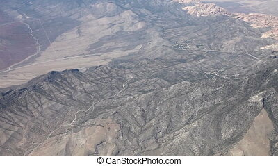 Flying above mountains and desert - Aerial view from an...