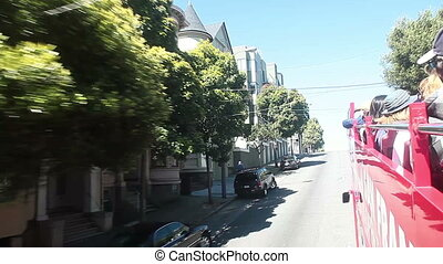 Touring San Francisco - On a open deck tour bus in San...