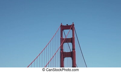 Golden gate bridge zoom out - Zoom out from the tower to San...