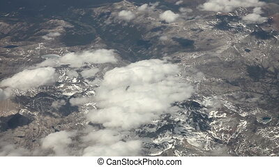 Flying above snowy mountains - Aerial view from an airplane...