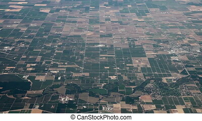 Flying above very flat land - Aerial view from an airplane...