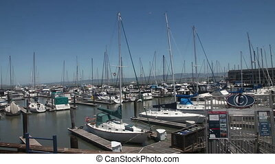 Pier 39 sail boat port - Pan over pier 39 port on San...