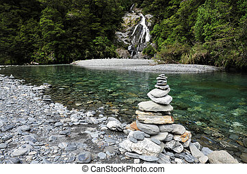 Fantail Falls, West Coast, New Zealand - Stacks of rocks at...