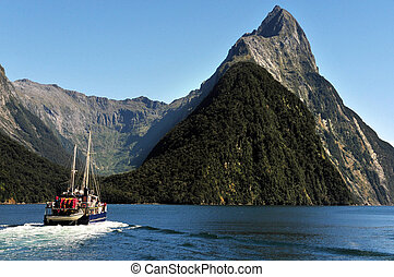New Zealand Fiordland - Ship sail under Mitre Peak in...