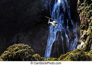 New Zealand Fiordland - A helicopter flies over Fiordland,...