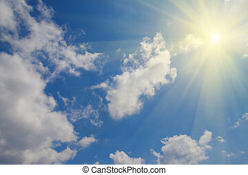 The sun in the clouds in a blue sky. Can be used as a...