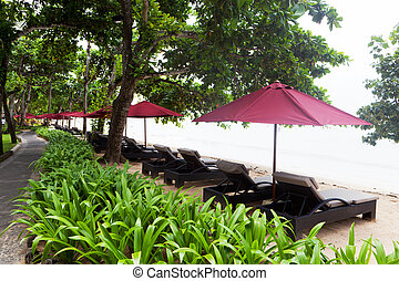 Canopies from the sun on a beach in Bali