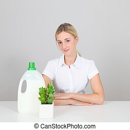 Woman presenting organic laundry detergent