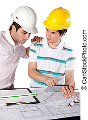 Two Architects Using Digital Tablet