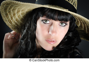 Portrait of beautiful woman with straw hat