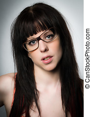 Portrait of attractive brunette with glasses