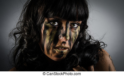 Dark and mysterious with camoflauge paint on face