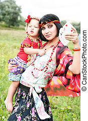 beautiful gypsy girl in a red dress with the baby. Guesses...