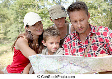 Family looking at map on a hiking day