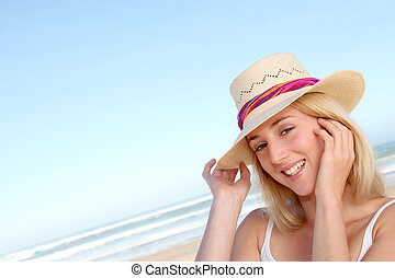 Portrait of beautiful woman at the beach