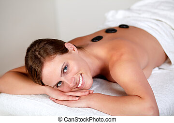 Young girl smiling and relaxing at spa