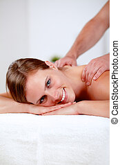 Young blonde girl relaxing at a spa