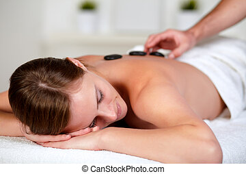 Tired young female relaxing at a spa - Close up portrait of...