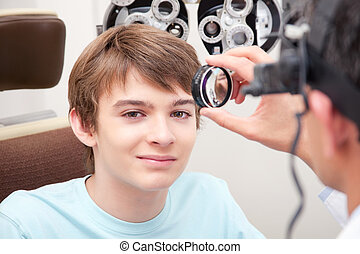 Eyesight Test Examination - Optometrist taking an eyesight...